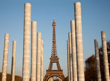 Eiffel tower and Peace Monument pillars Stock Photos