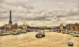 The Eiffel Tower and the Pont Alexandre III over the Seine river Stock Image