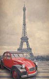 Eiffel Tower and red car with retro vintage style filter effect.  Royalty Free Stock Photos