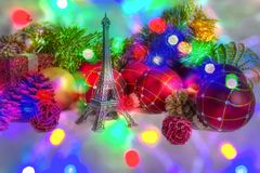 Christmas holiday in paris. Eiffel tower and red christmas decoration with beautiful christmas lights and bokeh effects stock images