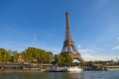 The Eiffel Tower from the river Seine in a sunny day in Paris, France. royalty free stock photos