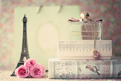 Eiffel tower with roses and perfume bottle Royalty Free Stock Photo