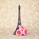 Eiffel tower with roses. Eiffel tower sculpture with pink roses Stock Photography