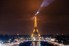 Eiffel Tower Searchlight. At Cloudy Night Stock Image