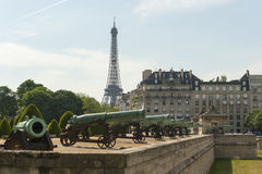 The Eiffel Tower seen behind buildings in Paris, France Royalty Free Stock Image