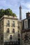 The Eiffel Tower seen behind buildings in Paris, France Stock Image
