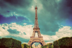 Eiffel Tower seen from Champ de Mars park in Paris, France. Vintage Stock Images
