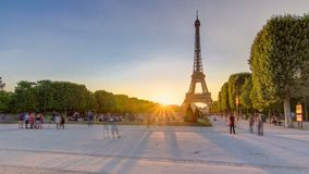 Eiffel Tower seen from Champ de Mars at sunset timelapse, Paris, France stock video footage