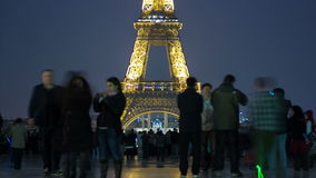 Eiffel Tower seen from Trocadero with crowd night. Timelapse and nice bokeh in Paris, France. Eiffel Tower is lit by more than 350 lamps mounted within the stock footage