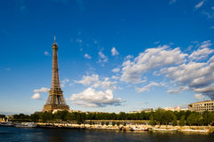 Eiffel Tower beside the Seine river. Eiffel Tower is standing beside the Seine , which makes the famous logo of Paris Royalty Free Stock Photography