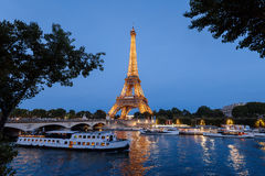 Eiffel Tower and Seine River by Night Stock Photography