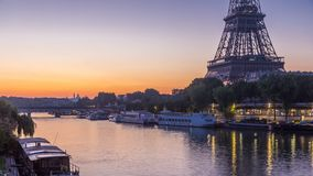 Eiffel Tower and the Seine river night to day timelapse, Paris, France. Eiffel Tower and the Seine river night to day transition timelapse before sunrise, Paris stock footage