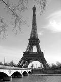 Eiffel Tower with Seine River, Paris, France. Black and White Photograph of the Eiffel Tower in Paris, with the Seine Rive flowing in the foreground Stock Photography