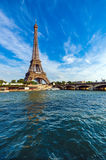 Eiffel Tower and Seine river with puffy clouds Royalty Free Stock Images