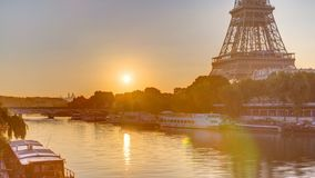 Eiffel Tower and the Seine river at Sunrise timelapse, Paris, France. Morning view from Bir-Hakeim bridge with reflections on water stock video footage
