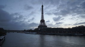 Eiffel Tower and Seine River in twilight just before sunrise with passing clouds. Paris stock video