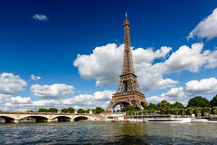 Eiffel Tower and Seine River with White Clouds in Background Royalty Free Stock Image