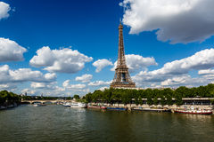 Eiffel Tower and Seine River with White Clouds in Background Stock Photography
