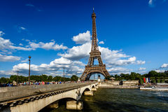 Eiffel Tower and Seine River with White Clouds in Background Royalty Free Stock Images