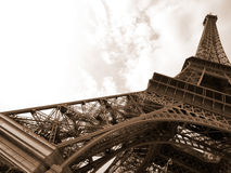 Eiffel tower in sepia color. Eiffel tower against a sky background in sepia color Stock Photos