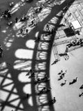 Eiffel Tower Shadow. Tourists at the base and entrance of the Eiffel Tower with its shadow being cast Royalty Free Stock Photos
