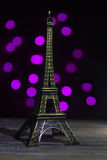 Eiffel tower shot in studio with bokeh lights in backgound Royalty Free Stock Image