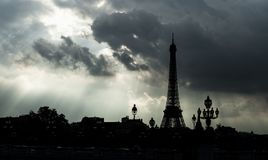 Eiffel tower silhouette, Paris symbol and iconic landmark in France, on a cloudy day with dramatic sky. Famous touristic. Places and romantic travel Stock Photography