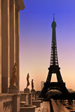 Eiffel Tower and silhouettes of sculptures. Royalty Free Stock Images