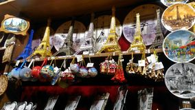 Eiffel Tower Souvenirs of different styles. royalty free stock photo