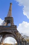 The Eiffel Tower in Spring. Eiffel tower with good sightseeing weather, fluffy clouds. Composition leaves copy-space Royalty Free Stock Image