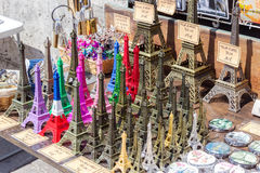 Eiffel tower statuettes. Being sold at a tourist stand in Paris, France Royalty Free Stock Images