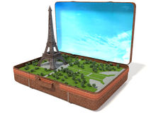 Eiffel tower in a suitcase Stock Photos