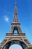 Eiffel Tower. On a sunny day on a background of blue sky Stock Photo