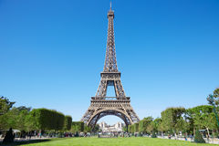 Eiffel tower, sunny summer day with blue sky and green grass Royalty Free Stock Image