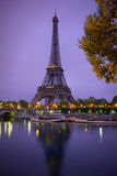 Eiffel Tower in sunrise at Seine, Paris. Eiffel Tower in sunrise with street lights at Seine, Paris royalty free stock images