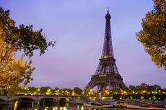Eiffel Tower in sunrise at Seine, Paris. Eiffel Tower in sunrise with street lights at Seine, Paris stock images