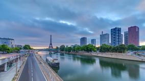 Eiffel Tower sunrise timelapse with boats on Seine river and in Paris, France. View from Grenelle bridge. Modern buildings and traffic on a road stock video