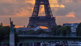 Eiffel Tower sunrise timelapse with boats on Seine river and in Paris, France. View from Mirabeau bridge. Close up view. The Statue of Liberty on the left stock video footage