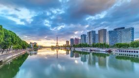 Eiffel Tower sunrise timelapse with boats on Seine river and in Paris, France. View from Mirabeau bridge. Modern buildings and traffic on a road. The Statue of stock video