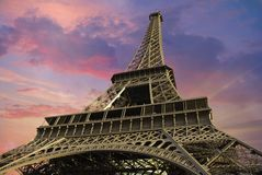 Eiffel Tower at Sunset against a Cloudy Sky Royalty Free Stock Photo