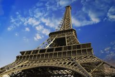 Eiffel Tower at Sunset against a Cloudy Sky Stock Photography