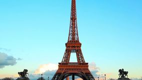 Eiffel tower on sunset and blue sky, car traffic stock footage