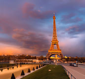 Eiffel tower on a sunset half-lit with last rays of the setting Royalty Free Stock Photos