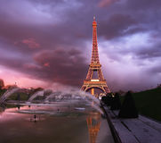 Eiffel tower on a sunset half-lit with last rays of the setting. Sun. Space for your text. This image is toned Royalty Free Stock Images