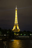 Eiffel Tower at sunset in Paris. PARIS, FRANCE - JULY 14 2014: Eiffel Tower at sunset is the most visited monument in France and the most famous symbol of Paris Royalty Free Stock Image