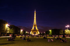 Eiffel Tower at sunset in Paris. PARIS, FRANCE - JULY 14 2014: Eiffel Tower at sunset is the most visited monument in France and the most famous symbol of Paris Royalty Free Stock Images