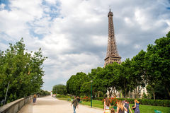 Eiffel Tower at sunset in Paris, France. Romantic travel background. Stock Photos