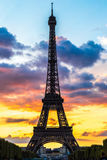 Eiffel Tower at sunset in Paris. Eiffel Tower at sunset is the most visited monument in France and the most famous symbol of Paris Royalty Free Stock Photography
