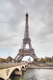 Eiffel tower surrounded by tourists Stock Image