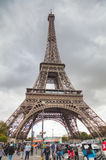 Eiffel tower surrounded by tourists Royalty Free Stock Photos